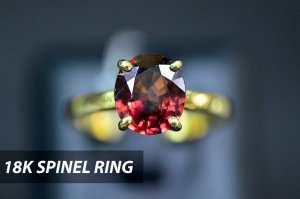 Spinel is a fascinating gem that occurs in many colors. Set in 18K yellow gold, this spinel ring flashes a fiery brilliance, a truly great treasure.