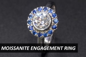 Moissanite as centerstone with blue sapphires ring in 18K white gold is perfect for a less boring engagement ring. Moissanite is conflict-free, zero mining gemstone suitable for eco friendly conscious young people like you.